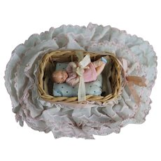 Vintage Miniature Bassinet with Rubber Baby Doll