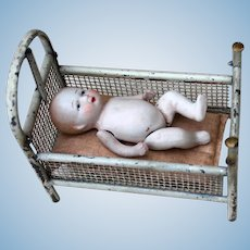 Vintage Metal Baby Crib with All Bisque Baby
