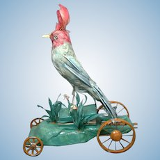 Large Mechanical Exotic Bird Pull Toy circa 1900 with Whistling Bellows on Wheels