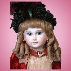 "27"" Schmitt & Fils French Bebe With Long Face, Hypnotic Blue Paperweight Eyes, Original Flat-Bottom Signed Body  circa 1879"