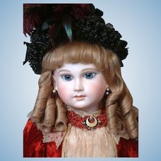 "27"" Schmitt & Fils French Bebe With Long Face, Hypnotic Blue Paperweight Eyes, Original Flat-Bottom Signed Body  circa 1879"