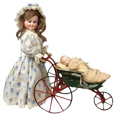 Rare Carl Bergner 3-Faced Doll head (1900) on earlier (Stevens & Brown 1870) Mechanical Doll body  Pushing Metal Stroller with 2-Faced All Bisque Baby