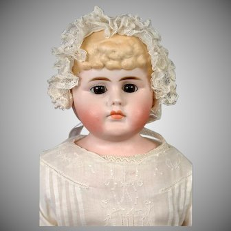 "Unusual Tinted Bisque Antique Child Shoulderhead Doll 21.5"" with Molded Bow and Glass Eyes"