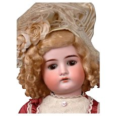 Cuno Otto Dressel 1912 Antique Bisque Child Doll in Maroon Bebe-Style Frock 22""