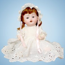 "Adorable 9"" German Baby Doll in White Dress"
