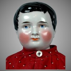 """22.5"""" Young Man China Doll with Unique Hair Style"""