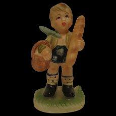 Napcoware Boy with Bread Figurine