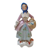 Porcelain Figurine Woman with Flower Basket
