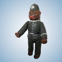 Celluloid french bulldog dressed as 'bobby' policeman