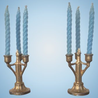 Couple of candle holders with blue candles