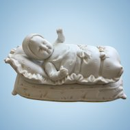 "Rare all-bisque box ""baby in bunting"" by Hertwig & Co,  1915."