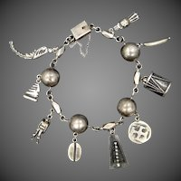 Mid Century Sterling Silver One of a Kind Charm Bracelet
