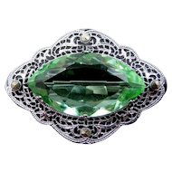 Art Deco Rhodium Plated Filigree Brooch with Peridot Green Glass Stone