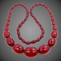 "Art Deco Cherry Amber Bakelite 28"" Long Necklace ~ Price is firm ~"
