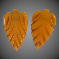Carved Orange Bakelite Dress Clips