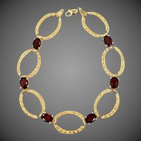 14k Gold Oval Open Links Garnet Bracelet