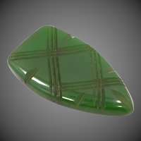 Dark Green Carved Bakelite Dress Clip