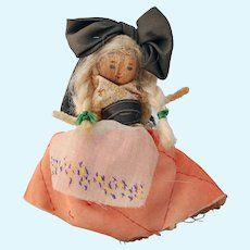 Folkart nut head doll French Alsace costume huge black hair bow mohair braids quilted padded skirt pipe cleaner body 4 inch