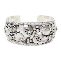Ornate wide Native American sterling silver cuff bracelet by Dawn Lucas