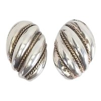 Elegant gold and sterling silver shrimp twisted style classic earrings by Tiffany Co