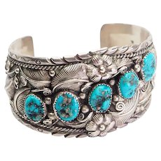 Vintage wide sterling silver turquoise Native American bracelet by Joeo Quail