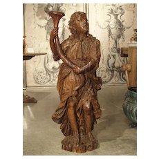 Circa 1650 Carved Hardwood Figural Cornucopia Statue from Italy