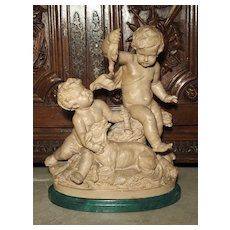 Late 19th Century French Terra Cotta Statue of Putti Teasing a Bird Dog