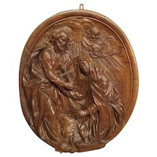 A Carved 18th Century Oval Wooden Religious Plaque from France