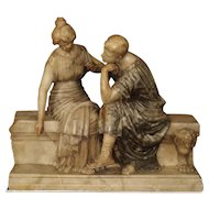 A Late 19th Century Marble and Alabaster Carving of a Couple Seated on a Bench