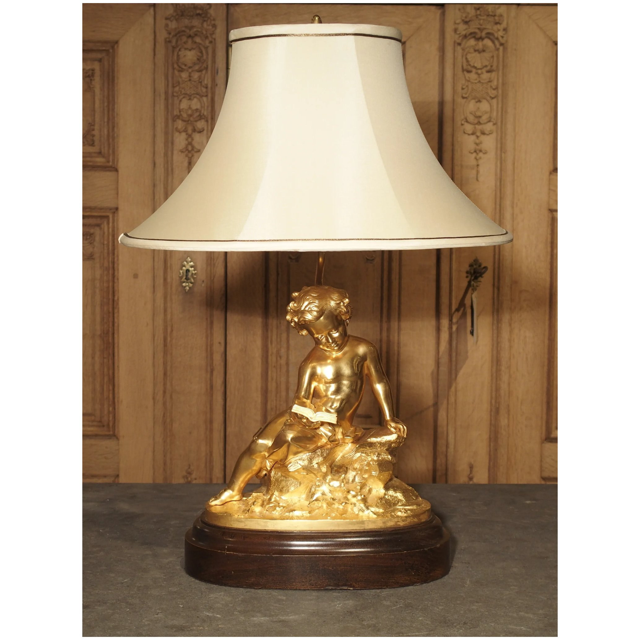 Picture of: Antique French Gilt Bronze Cherub Lamp On Wooden Base Le Louvre French Antiques Ruby Lane
