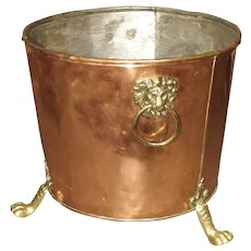 English Copper and Brass Log Bucket with Lion Head Ring Handles and Paw Feet