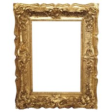 Opulent 19th Century French Louis XV Style Gold Leaf, Giltwood, and Plaster Frame