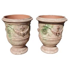 Pair of Mid Sized Distressed Terra Cotta Planters from Anduze France