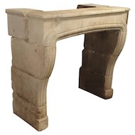 A Carved Limestone Fireplace Mantel from France