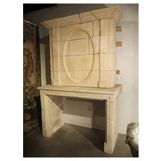 Early 1800s Carved Limestone Trumeau Fireplace Mantel from Loire Valley, France