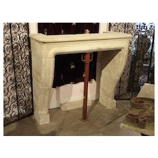 Carved and Distressed Italian Limestone Fireplace Mantel