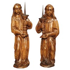 A Pair of French 17th Century Angel Candle Holders in Carved Elmwood