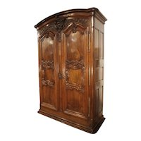 18th Century Lyonnaise Armoire in Carved Walnut Wood