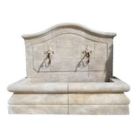 A French Limestone Wall Fountain with Carved Fleur De Lys Spouts