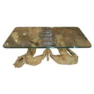 A Bronze Tritons Coffee Table with Glass Top