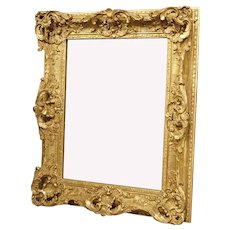 A Small Louis XV Style Gilt Composite and Wood Mirror from France