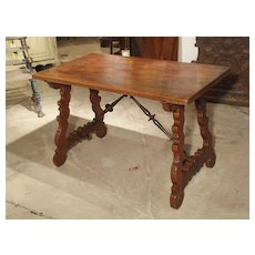 Antique Walnut Wood Table from Spain with Iron Stretchers and Carved Feet, Late 19th Century