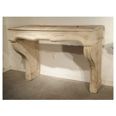 18th Century French Fireplace Mantel in Carved Limestone