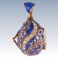Very unusual enamel egg pendant  with an angel inside