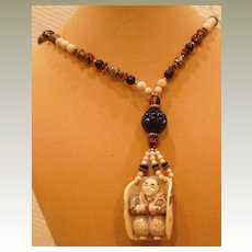 Faux Ivory Necklace with Double Sided Pendant  30 inches