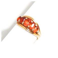 A Vintage 14 Karat Gold Mandarin Garnet Gemstone Ring