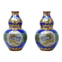Japanese 18th century Imari vases with enamel dragon design