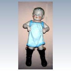 "10"" tall Gebruder Heubach ""Boy Walking in Daddy""s Boots"""