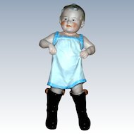 "10"" tall Gebruder Heubach ""Boy Walking in Daddy""s Boots"""