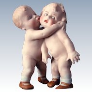 Gebruder Heubach Hugging Children Vase/Match Holder